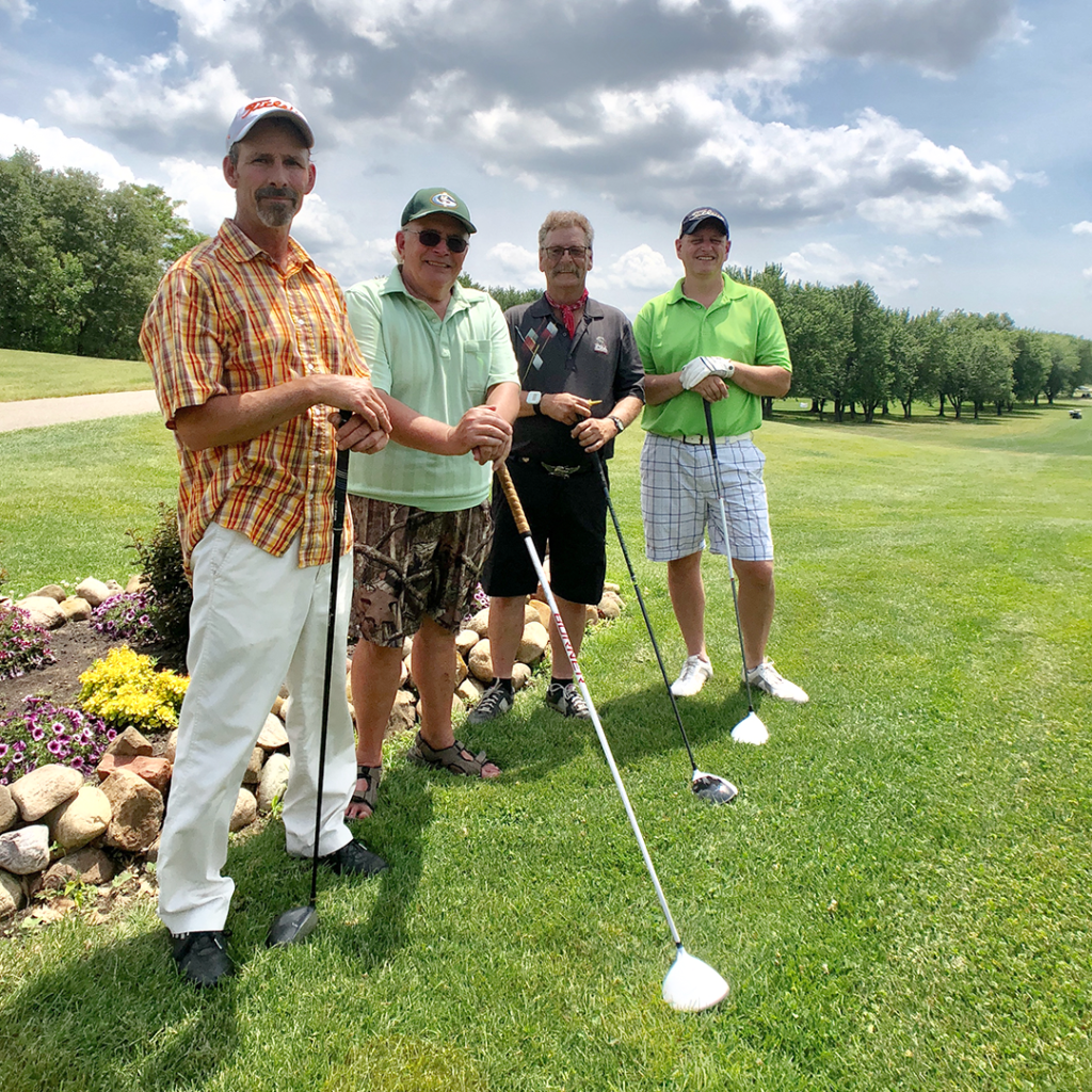 A group of golfers having fun at the Sixth Annual Golf Outing.