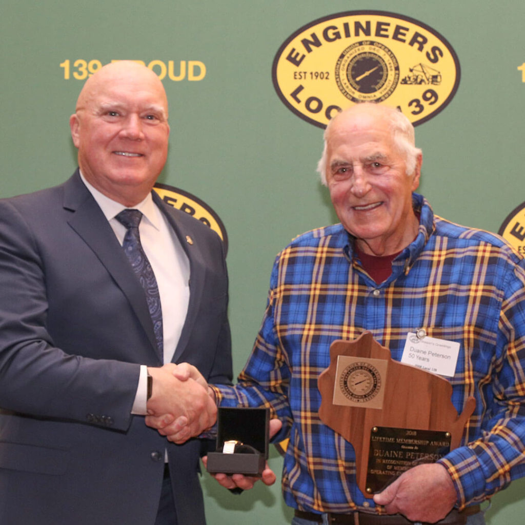 50-Year member Duane Peterson pictured with Terry McGowan